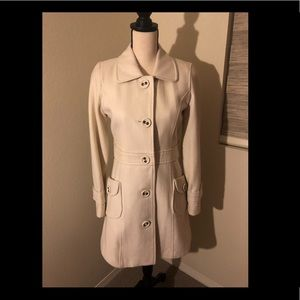 Cream color trench coat. Size M
